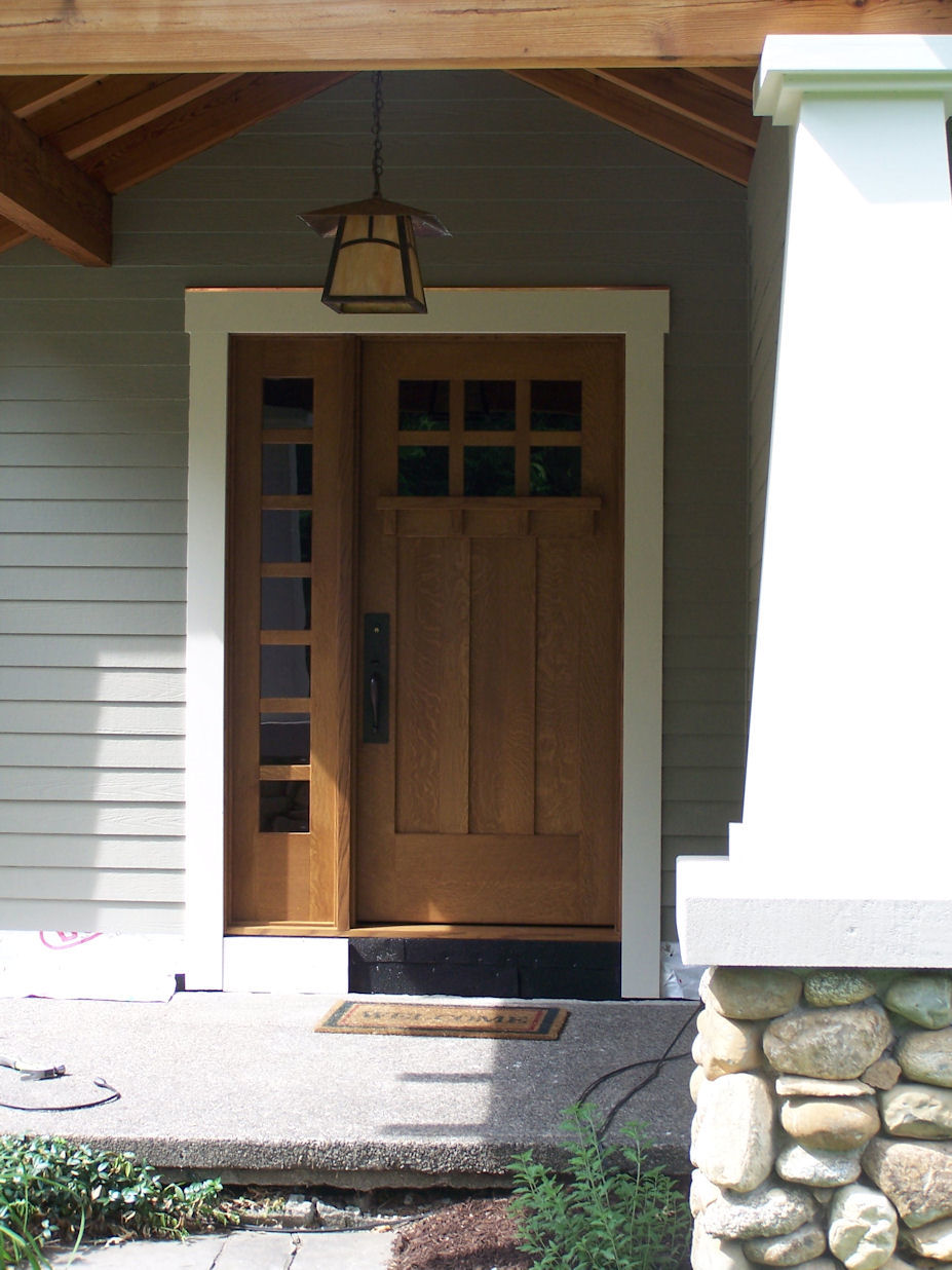 Entry Door Designs graceful exterior house design ideas with brown wood entry doors between glass windows Heart Of Oak Workshop Authentic Craftsman Mission Style Door Designs